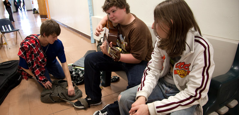 CHA High School students hanging out and playing guitar - private special education school in Lincoln Park NJ