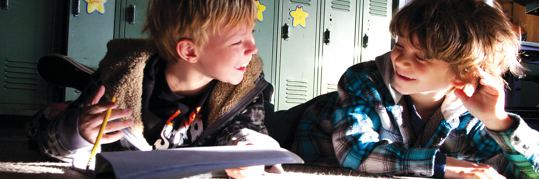 Two Elementary students reading in sunny hallway - private spceial education school in Lincoln Park NJ