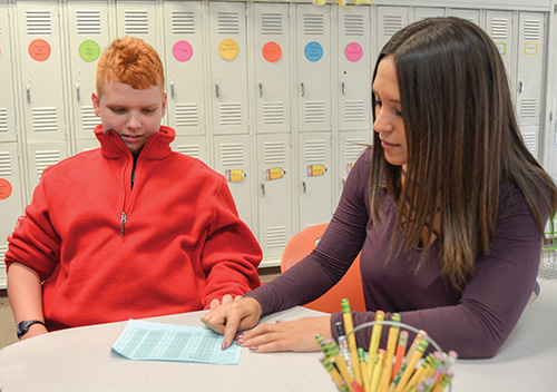 CHA student working with a teacher on his individualized behavioral plan